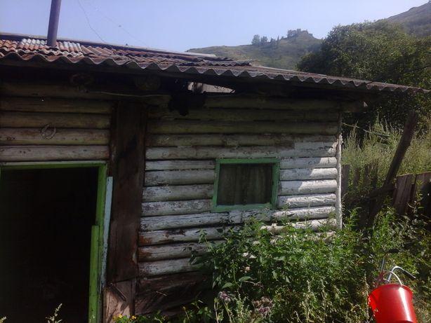 Домик с садом в горах