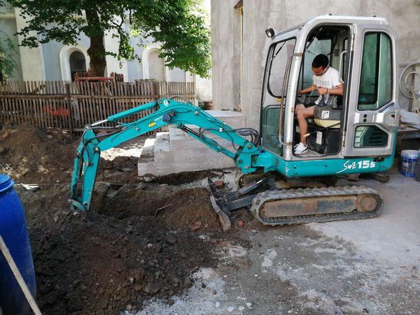 Miniexcavator (execut lucrări)
