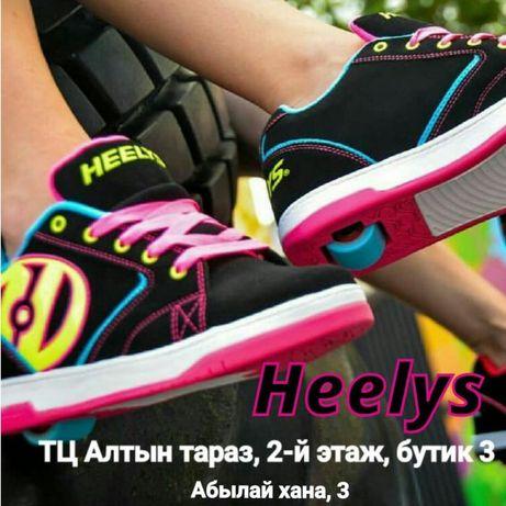 Роликовые кроссовки хилисы на роликах Heelys в центре города