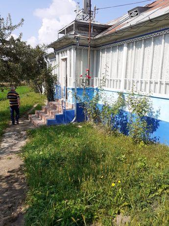 Vând teren cu casa batraneasca in comuna Mădârjac, la 50 km de Iasi