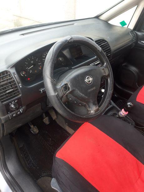 Opel zafira a schimb cu zafira b sau vw touran + dif din partea mea