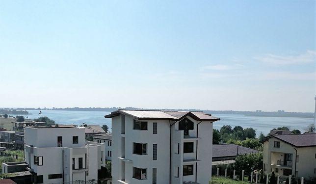 Apartamente duplex, curte proprie, garsoniere, vedere spre lac si mare