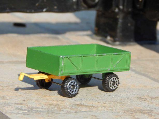 Macheta remorca agricola metalica sc 1:64 cu osie fata mobila Zee Toys