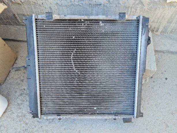 Радиатор на 124 2.2 обьем