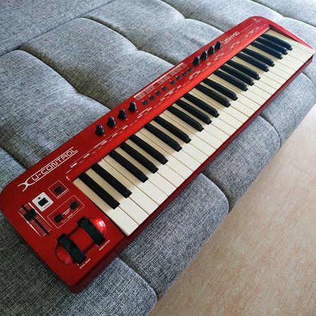 Продам Миди-клавиатуру Behringer UMX 49