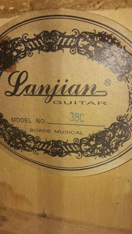 Продам гитару, платья на худенькую девушку 40-42 размера , карусель