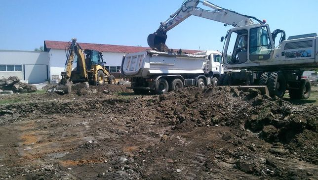 Buldoexcavator de inchiriat,transport agregate (nisip,pietris) balast