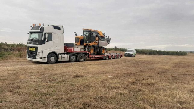 Transport agabaritic international , utilaje agricole & constructii