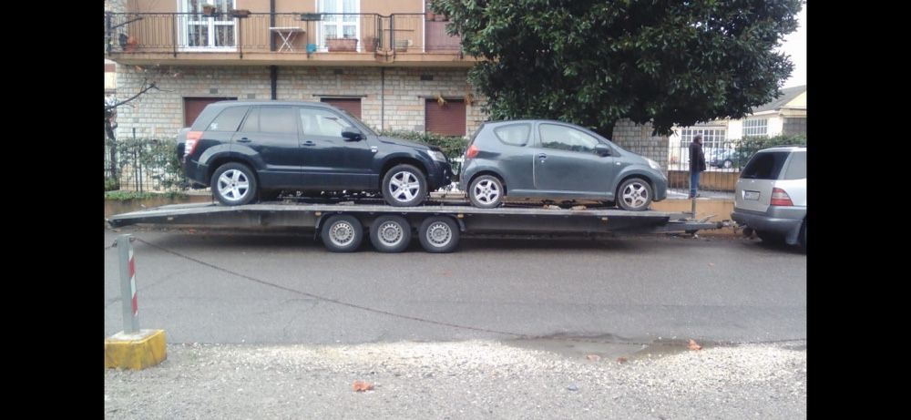Transport autoturisme pe platforma Romania Italia si retur