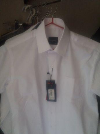 Сорочка белая, с длинным рукавом,  на мальчика 11-12 лет.