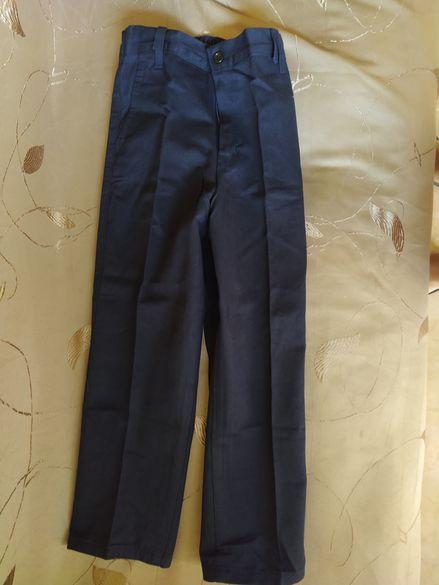 122- за 7 год.  2 бр. нови официални тъмно сини панталони