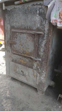 Продам печь газовую и твердотопливную .