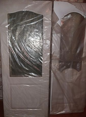 Новые в упаковке двери белый заводские Россия 60-80-90 см,стекло рефл