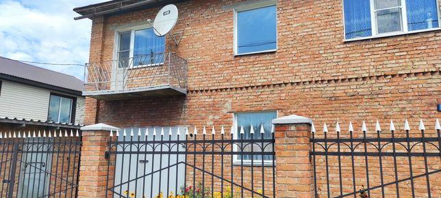 Продам дом два уровня район Левый берег.