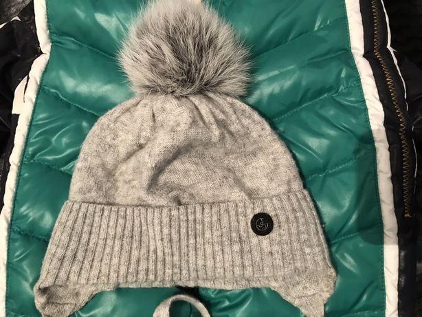 Продам кашемировую шапочку на малыша возраст от 2-9 месяцев