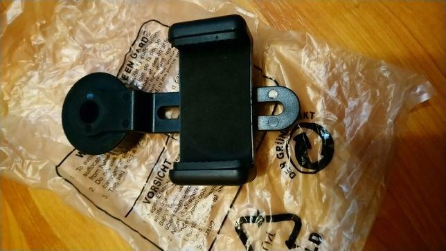 Dispozitiv atasare telefon mobil pentru monoclu.