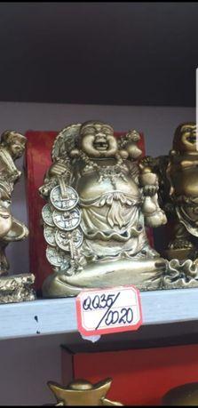 Buddha cu monede pe sacul abundentei