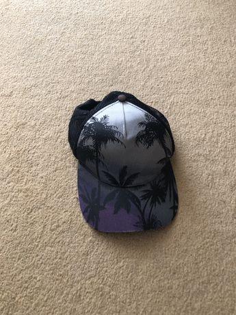 Șapca cu palmieri