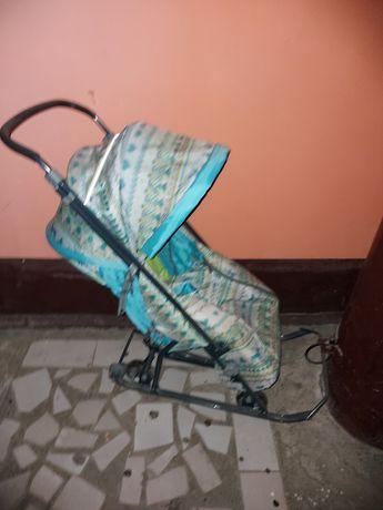 Продам санки коляска  в хорошем состоянии за.