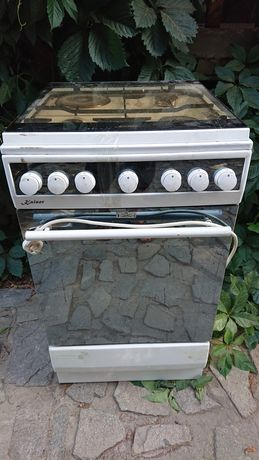 Газовая плита ,духовка .