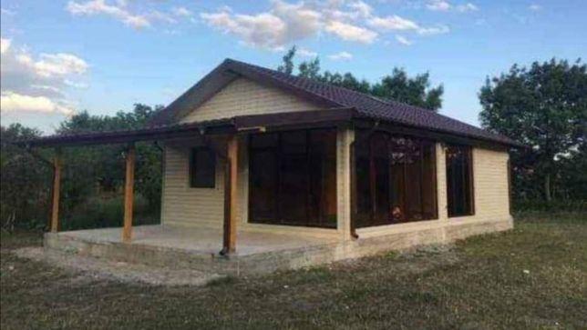 Vand costruiesc casa din lemn