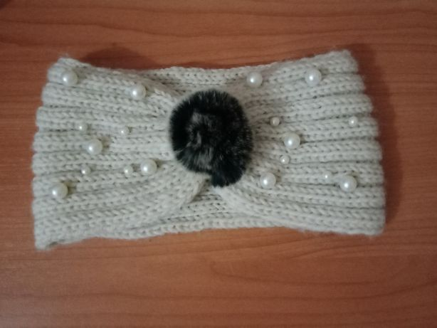 женская вязанная повязка