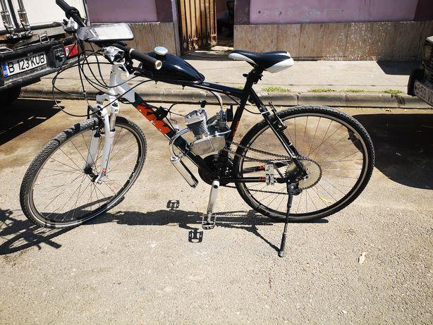Vând bicicleta KTM cu motor