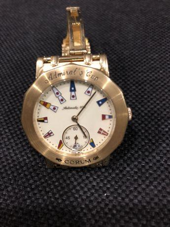Часы CORUM золотые