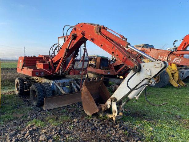 Dezmembrez Excavator pe roti Faun , pompa , motor , punti etc