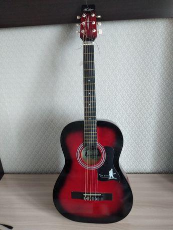 Продам гитару,новая
