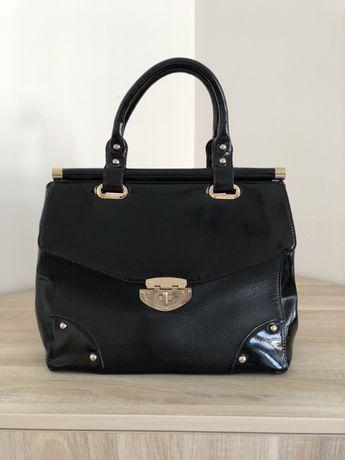 Стилна кожена чанта DUNE