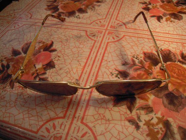 Ochelari de soare dama, stare foarte buna, distanta intre brate 14 cm.