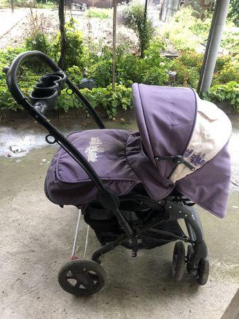 Комбинирана реверсивна количка с люлеещ механизъм за бебето и детето