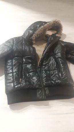Куртка тёплая на мальчика среднего телосложения  от 7-9 лет.