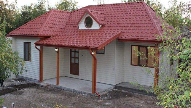 Casa, garaje auto si containere tip birou din panou sandwich izolat