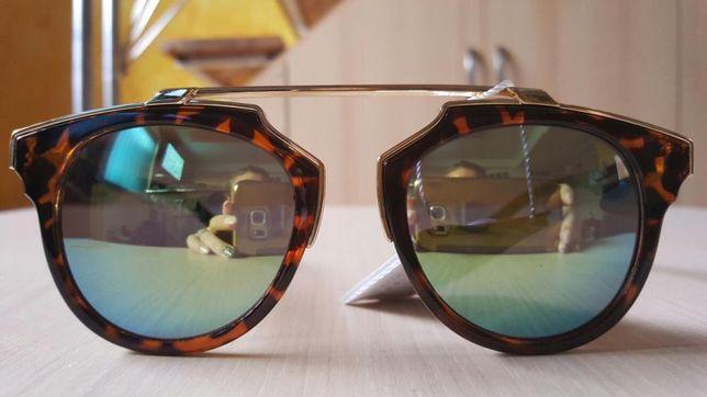 ochelari soare dama reflectă lumina
