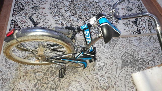 Продам велосипед для подроскового возроста.цвет синий Stels.