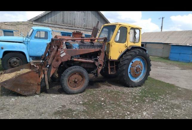 Продам трактор с ковшом.