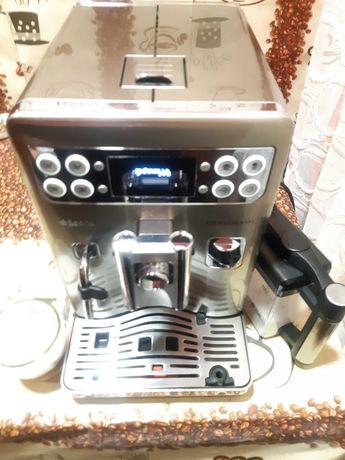 Vand un aparat de cafea marca saeco Exprelia  evo  se ofera garantie