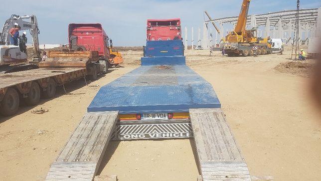 Transport utilaje cu trailer