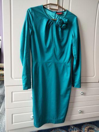 Платье от Valentino.