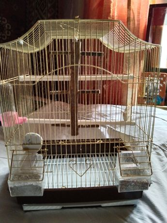 Клетка для птиц золотистая
