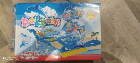 Делфини музикална играчка