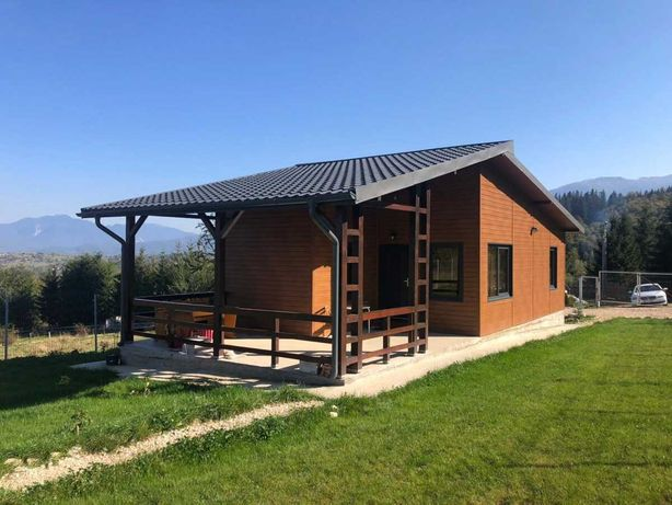 Casa, containere, garaje din panou sandwich si cabane din lemn stil A