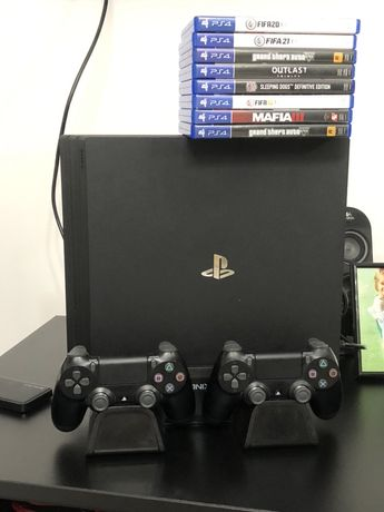 Play station 4 pro 1 Tb