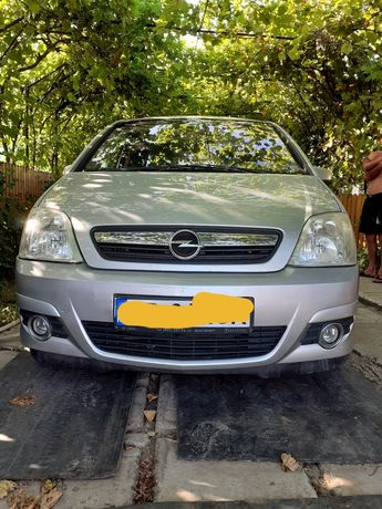 ,, Opel Meriva .
