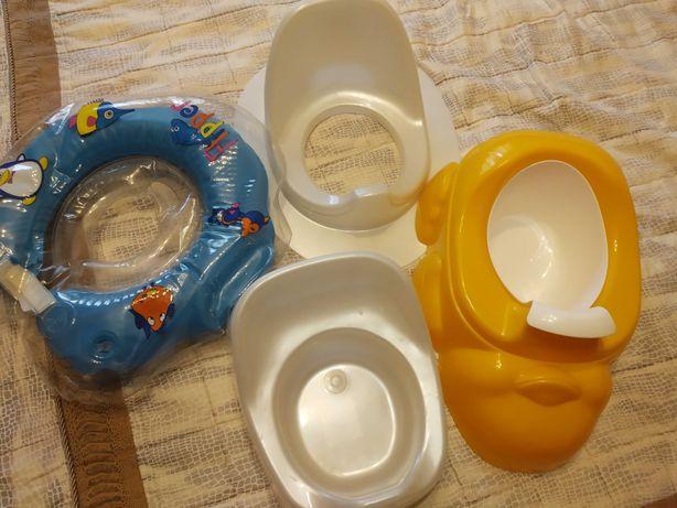 Детские горшки ,детское сиденье на унитаз и круг на шею для купания.