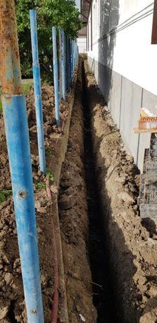 Sapatura mecanizata, piconare, gauri pentru stalpi cu miniexcavator