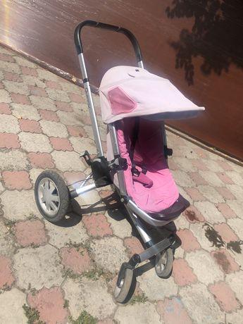 Детская коляска с люлькой марки Quinny