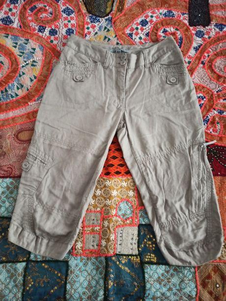 Pantaloni trei sferturi, cu multe buzunare
